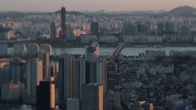traffic drive past buildings in this video taken with a tilt-shift lens in seoul, south korea, on thursday, july 16 buildings stand in this video... - general view stock videos & royalty-free footage