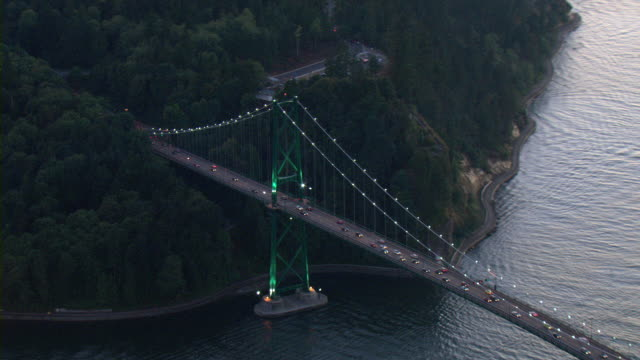Traffic drives across Lions Gate Bridge in Vancouver, Canada.