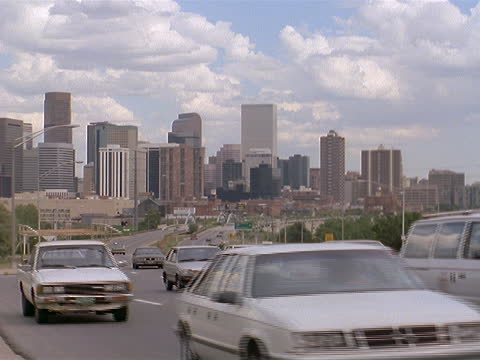 traffic drives along a highway, moving away from the denver skyline. - colorado stock videos & royalty-free footage
