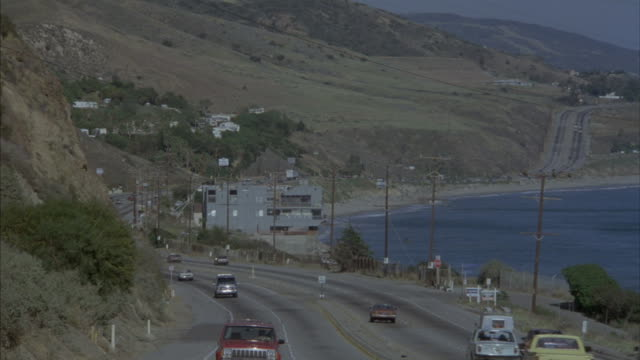 Traffic drives along a Pacific coast highway near Malibu, California.