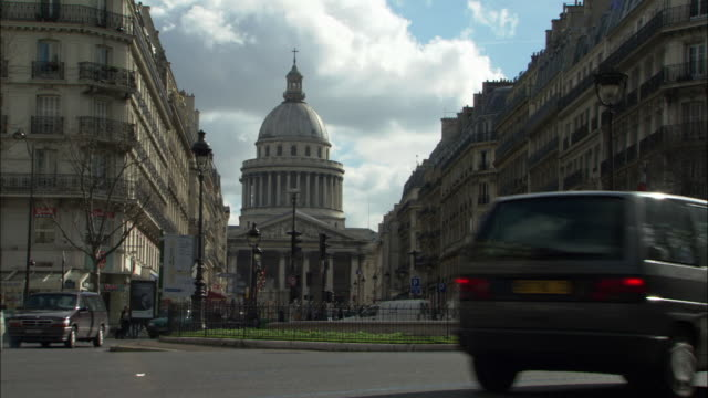 traffic drives along a roundabout in front of the pantheon in paris. - pantheon paris stock videos & royalty-free footage