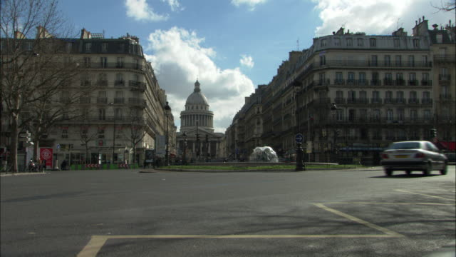 traffic drives along a roundabout near the pantheon in paris. - roundabout stock videos & royalty-free footage