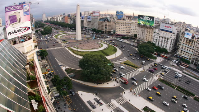 traffic drives around the obelisk of buenos aires on republic square. - plaza de la república buenos aires stock videos & royalty-free footage