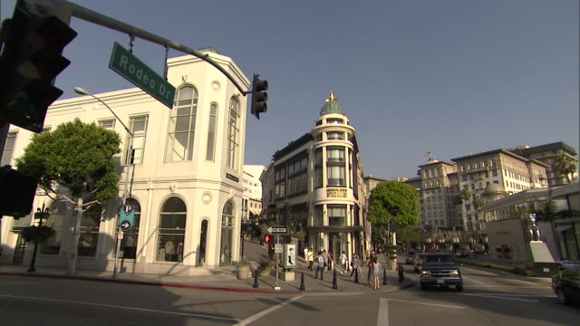 Traffic drives down Rodeo Drive in Beverly Hills, California