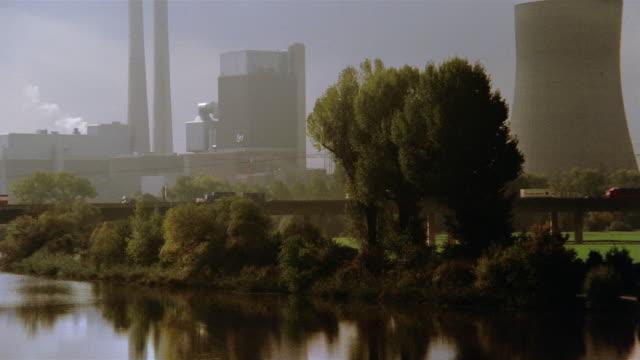 traffic drives near a nuclear plant on germany's neckar river. - neckar river stock videos & royalty-free footage