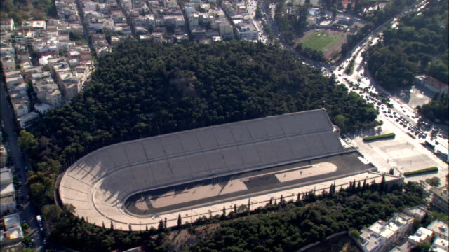 traffic drives near a restored roman stadium in athens, greece. - ancient stock videos & royalty-free footage