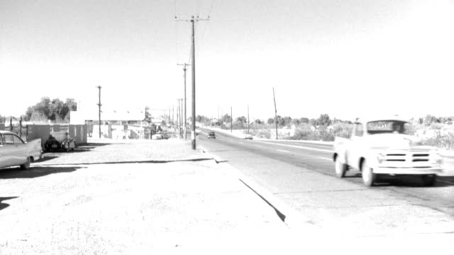 traffic drives on a desert highway. - 1950 1959 stock videos & royalty-free footage