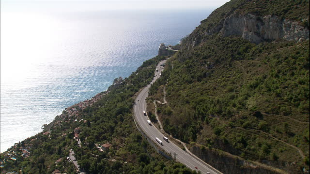 traffic drives on a mountain highway along the french riviera. - cote d'azur stock videos & royalty-free footage