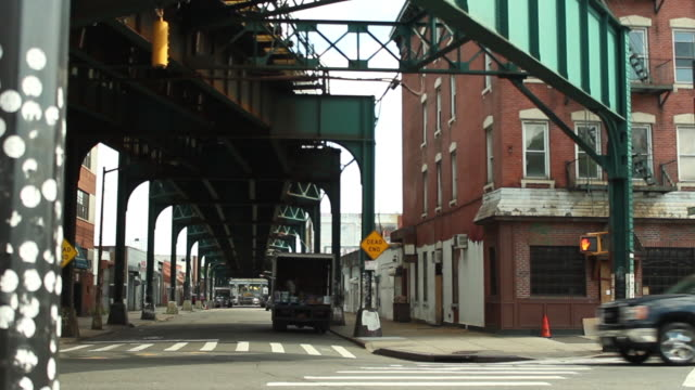 traffic drives on urban street - queens stock-videos und b-roll-filmmaterial