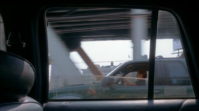 traffic drives over the manhattan bridge in new york city. - suspension bridge stock videos & royalty-free footage