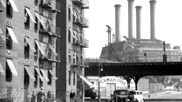 traffic drives past an apartment building near a factory. - 1958 stock videos & royalty-free footage