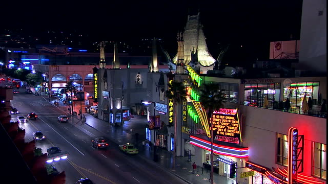 Traffic drives past Graumans Chinese Theater.