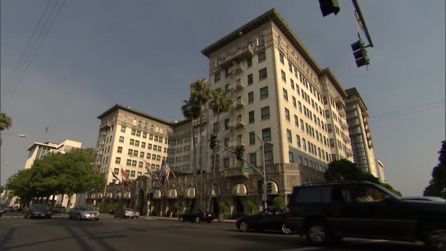 Traffic drives past the Regent Beverly Wilshire Hotel.