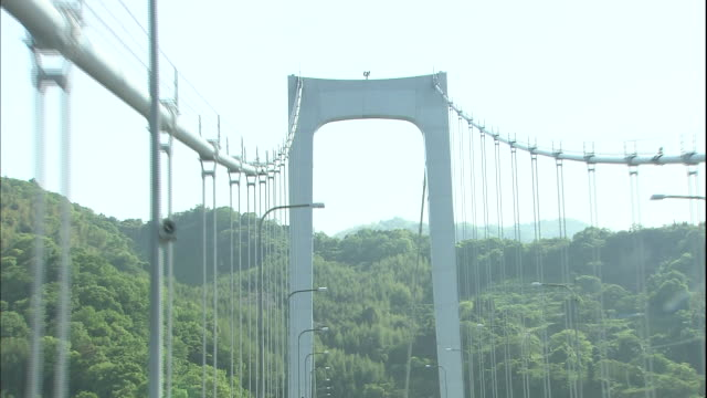 traffic drives through the hakata-oshima bridge in setouchi shimanami kaido expressway - nishiseto expressway stock videos & royalty-free footage