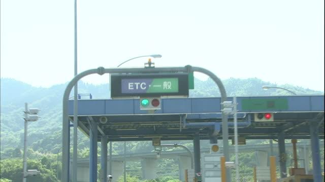 traffic drives through the toll gate of omishima in setouchi simanami kaido expressway - nishiseto expressway stock videos & royalty-free footage
