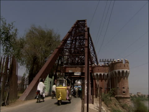 traffic driving from bridge onto road karachi sindh - karachi stock videos and b-roll footage