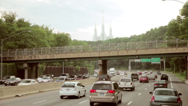 ms pov traffic driving in front of mormon temple capital highway / kensington, maryland, united states - mormon temple stock videos and b-roll footage