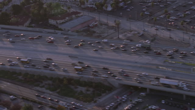 aerial traffic driving on a semi-congested freeway / los angeles, california, united states - tracking shot stock videos & royalty-free footage