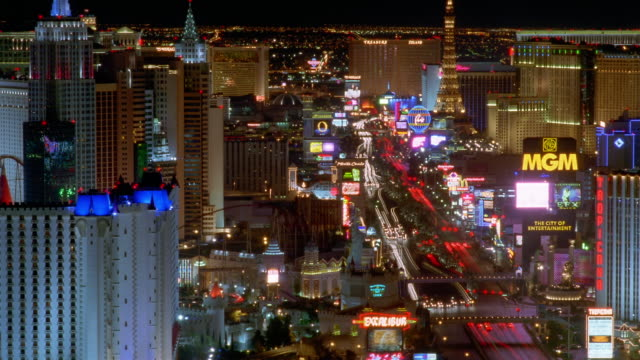 tl ha ws traffic driving on busy street past illuminated landmarks on the strip / las vegas, nevada, usa - replica della torre eiffel video stock e b–roll