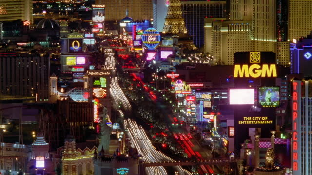 tl ha ws traffic driving on busy street past illuminated landmarks on the strip / las vegas, nevada, usa - the mirage las vegas stock videos & royalty-free footage