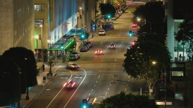 t/l ha ws traffic driving on flower street with view south between 6th street and wilshire boulevard / los angeles, california, usa - wilshire boulevard stock videos & royalty-free footage
