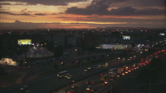 ha ws traffic driving on highway at sunset / bogota, colombia - bogota stock videos & royalty-free footage