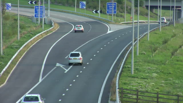 ha ws traffic driving on m25 motorway in early evening / london, england - m25 video stock e b–roll