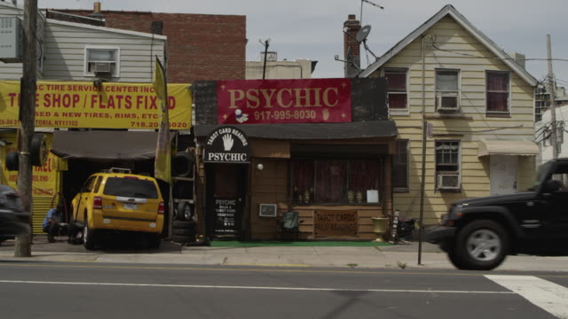 MS Traffic driving past a tire shop and a psychic.