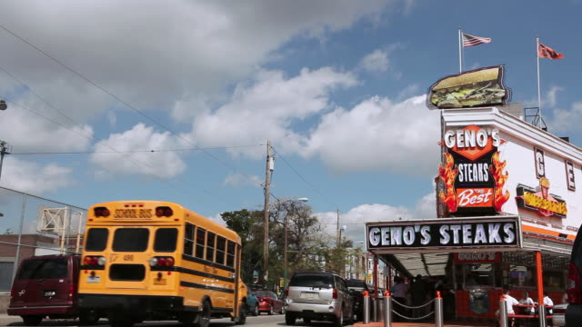 WS Traffic driving past Geno's Steaks / Philadelphia, Pennsylvania, United States