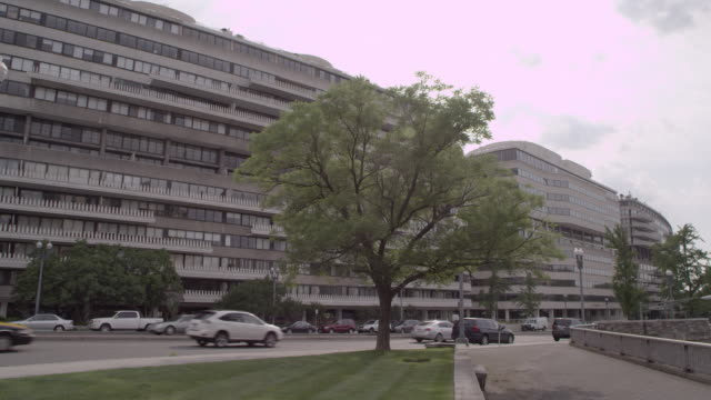 ws traffic driving past watergate complex / washington dc, united states - watergate scandal stock videos & royalty-free footage