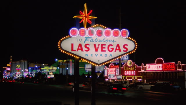 tl ws traffic driving past welcome to fabulous las vegas nevada sign / las vegas, nevada, usa - las vegas stock videos & royalty-free footage