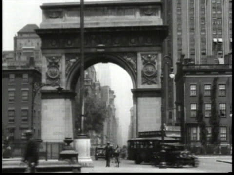 1932 montage traffic driving through washington square arch, people sitting on top of a double-decker bus driving on city street / new york city, new york, united states - 1932 stock videos & royalty-free footage