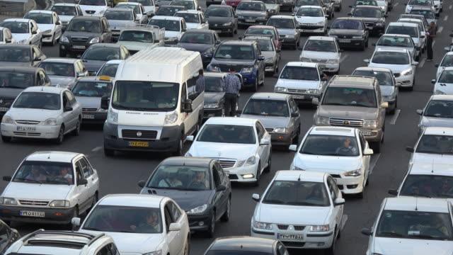 traffic during rush hour in tehran - 渋滞点の映像素材/bロール