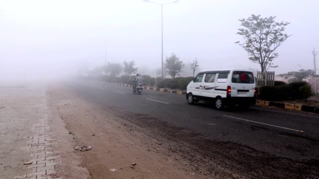 traffic during winter season - smog stock videos & royalty-free footage