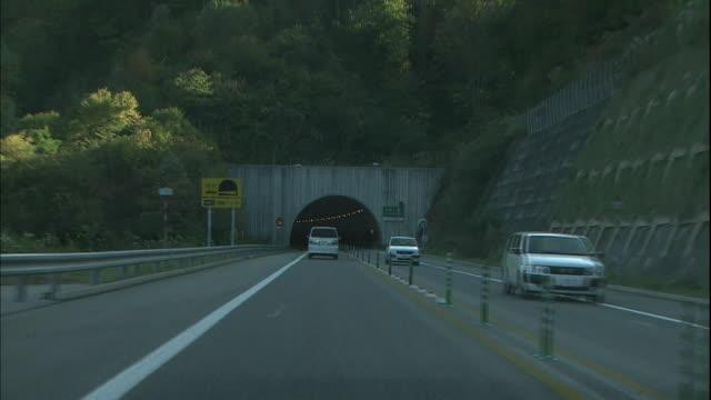 Traffic enters a tunnel on the Tokai-Hokuriku Expressway.