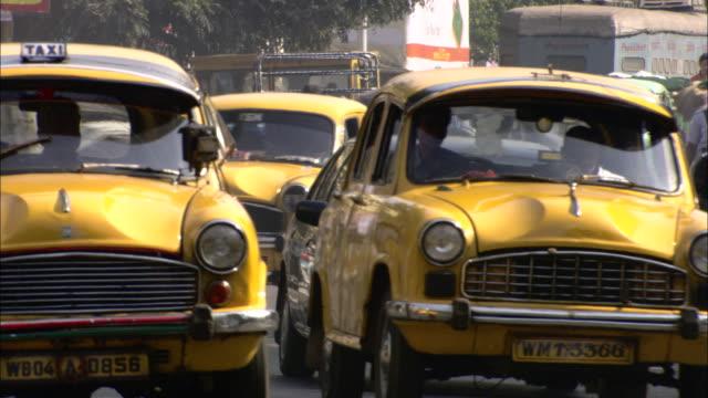 traffic fills a busy street. - kolkata stock videos & royalty-free footage