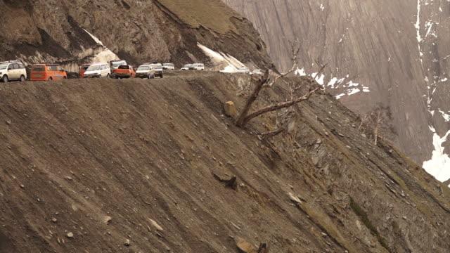 traffic flow along  dangerous zoji la, ladakh - mountain pass stock videos & royalty-free footage