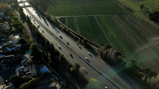 traffic flowing by below in northern california bay area - autostrada video stock e b–roll