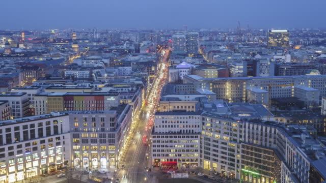 traffic flowing through potsdamer platz in central berlin. - berlin stock-videos und b-roll-filmmaterial