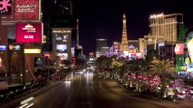 traffic flows along the las vegas strip at night. - the strip las vegas stock videos & royalty-free footage