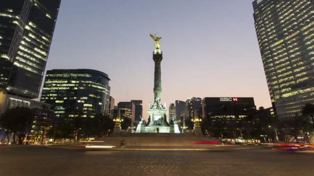 TL, WS Traffic flows around El Angel de la Independencia in downtown Mexico City at dusk / Mexico City, Mexico
