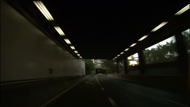 traffic flows beneath underpasses and through a tunnel in sydney, australia. - car point of view stock videos & royalty-free footage