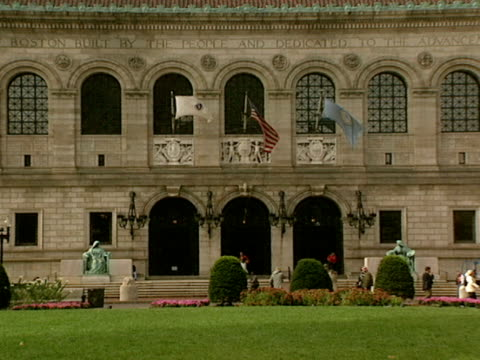 traffic flows in front of the boston public library. - back bay boston stock videos & royalty-free footage