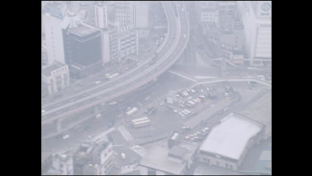 Traffic flows on a highway near Ueno Station on a smoggy day in Taito, Tokyo.