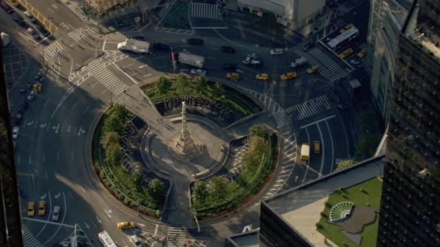 traffic flows through columbus circle in new york city. - columbus circle stock videos & royalty-free footage