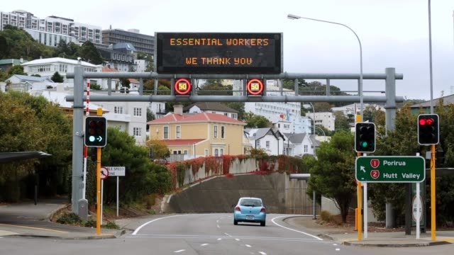 traffic goes by as a message to essential service workers is displayed on an electronic billboard above wellington motorway on april 11, 2020 in... - new zealand stock videos & royalty-free footage