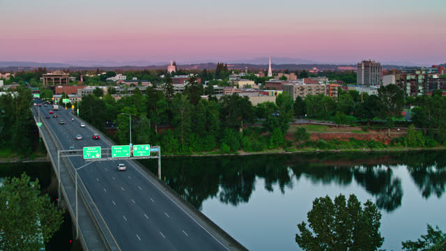 traffic heading into salem, or at dusk - aerial - oregon us state stock videos & royalty-free footage