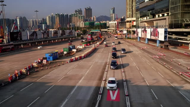 traffic heading towards a toll booth, kowloon, hong kong - urban sprawl stock videos & royalty-free footage