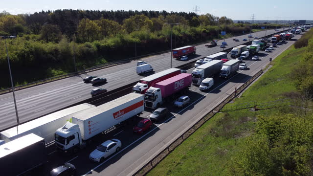 traffic held up in congestion on the m1 motorway, hertfordshire. - articulated lorry stock videos & royalty-free footage