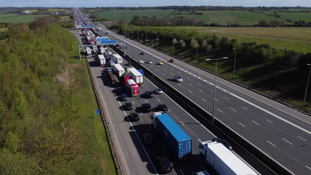 traffic held up in congestion on the m1 motorway, hertfordshire. - waiting in line stock videos & royalty-free footage